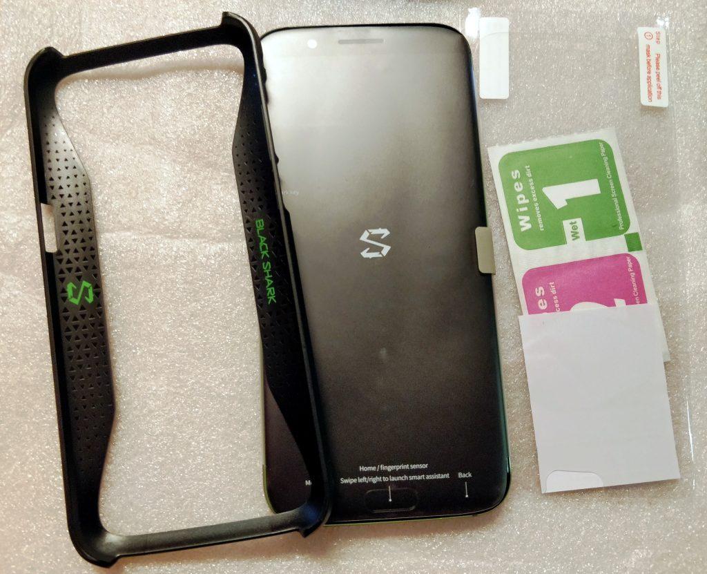 Plastový rámeček, telefon a fólie